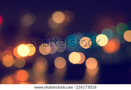 Lights blurred bokeh background from christmas night party for your design, vintage or retro color toned  - stock photo