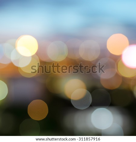 Lights blurred bokeh background in night city street. Defocused city night filtered bokeh abstract background. - stock photo