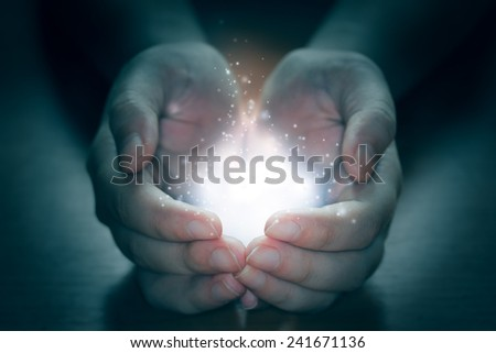 Lights in the human hands in the dark - stock photo