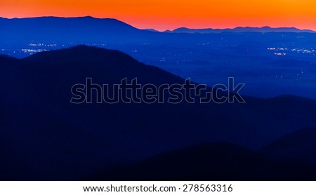 Lights in the Shenandoah Valley and ridges of the Appalachian Mountains, seen after sunset from Blackrock Summit in Shenandoah National Park, Virginia. - stock photo