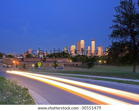 Lights of moving car on the street in Minneapolis - stock photo
