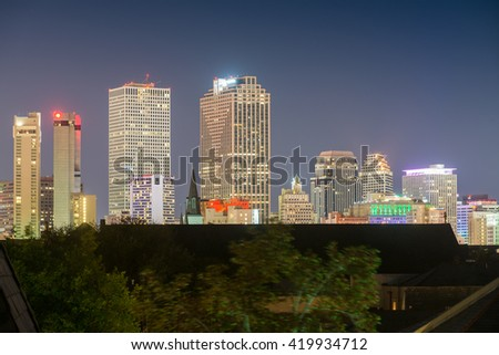 Lights of New Orleans, LA. City skyline at night.