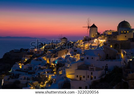 Lights of Oia village at night, Santorini, Greece. - stock photo