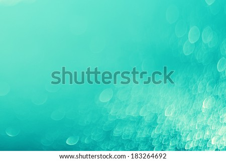 Lights on blue background.Underwater,bubbles.Vintage toned. - stock photo