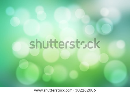 Lights on green background. Blurred background. - stock photo