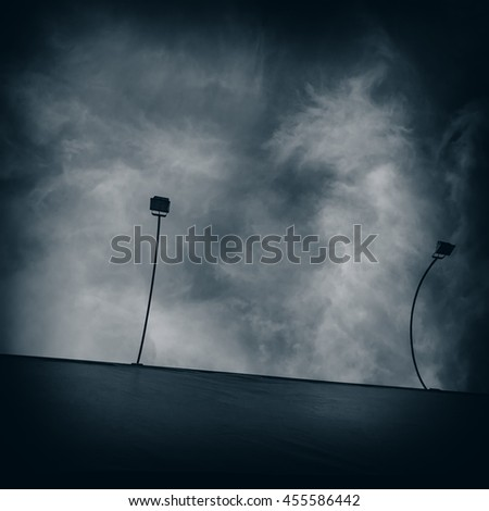 lights to illuminate the billboard on the background of sky and clouds - stock photo