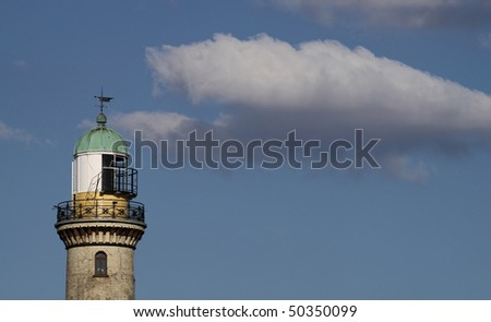 Lighttower of Warnem�¼nde (Germany) with copy space - stock photo