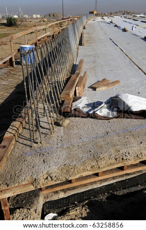 Lightweight concrete bridge surface has been poured using reinforcing bars and wooden forms - stock photo