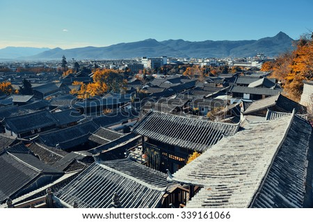 Lijiang Old Town mountain top view with local historical architectures - stock photo