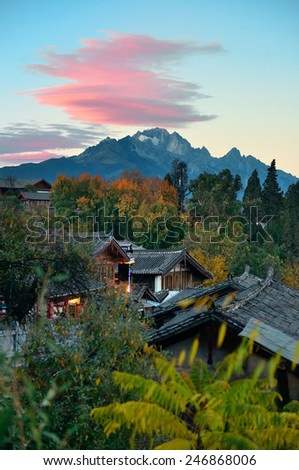 Lijiang Old Town with local historical architectures and Jade Dragon Snow Mountain - stock photo