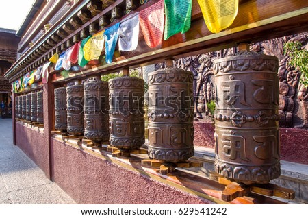 Lijiang,Yunnan - April 13,2017 : Prayer wheels in tibetan temple in Shuhe Ancient Town. It is one of the oldest habitats of Lijiang and well-preserved town on the Ancient Tea Route.