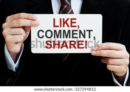 Like, comment, share! Man holding a card with a message text - stock photo