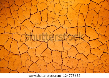 Like Dry Cracked Skin This Arid Earthen Background Is Iron Rich Dry Orange Colored Clay. - stock photo
