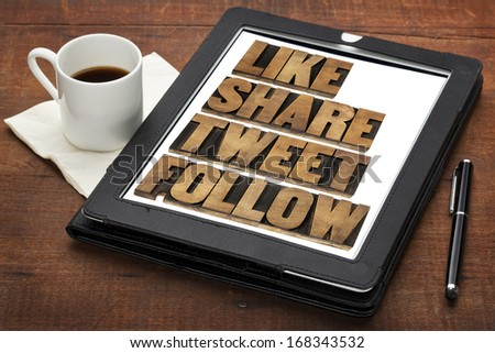 like, share, tweet, follow words - social media concept - isolated text in vintage letterpress wood type on a digital tablet with cup of coffee - stock photo