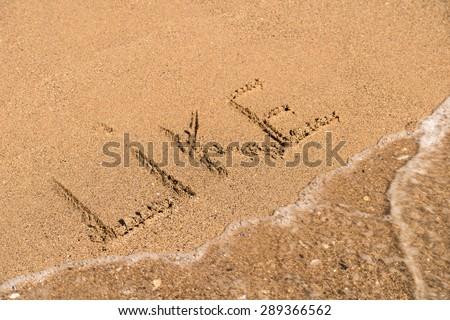 Like Word Written On Sunny Summer Beach Sand - stock photo