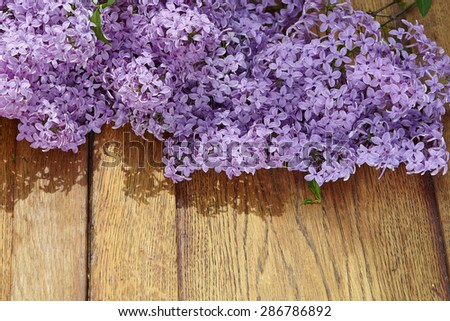 lilac flower on old wooden background - stock photo