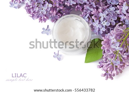 Lilac flowers and cosmetic cream isolated on white background. Natural cosmetic concept