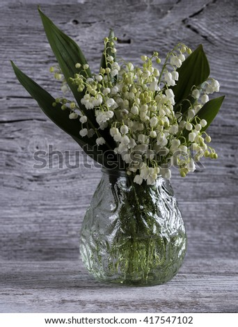 lilies of the valley in a glass vase - stock photo