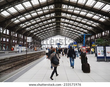 LILLE, FRANCE - AUGUST, 27, 2014. Traveling people on a platform at the railway station in Lille. This station is near the center of the city.