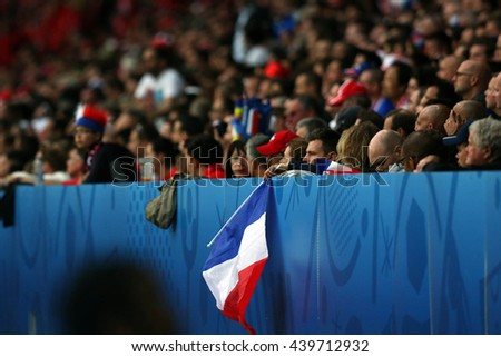 LILLE - FRANCE,  JUNE 2016 :  France flag in football match  of Euro 2016  in France between  Switzerland and France at the  Stade Pierre Mauroy  on June 17, 2016 in Lille.