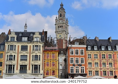 LILLE, FRANCE - SEPTEMBER 13: View of lively Place du General de Gaulle to the Belfry which is one of the town's landmark on September 13, 2014 in Lille, France - stock photo
