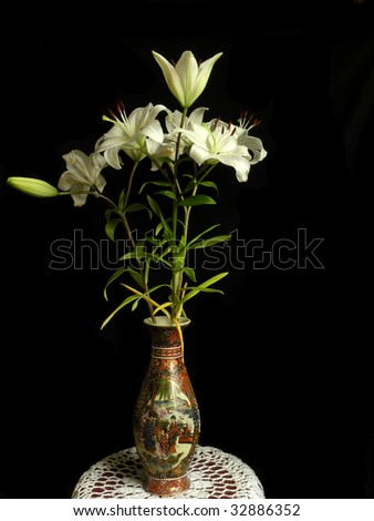 lillies in wase - stock photo