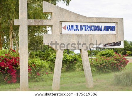 LILONGWE, MALAWI - JANUARY 13: a sign for Kamuzu International Airport on January 13, 2014 in Lilongwe, Malawi. Kamuzu is the busiest airport in Malawi with approximately 300,000 passengers per annum. - stock photo
