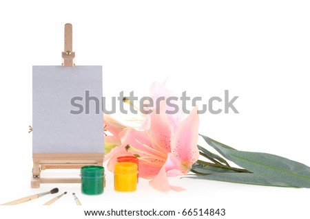 Lily flowers and set for painting with paints, brushes and easel - stock photo