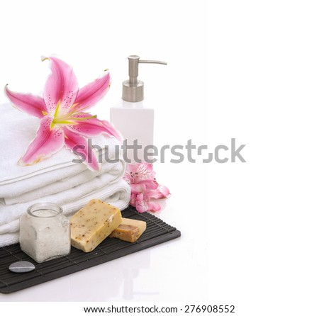 Lily on roller white towel and candle ,soap oil, on mat