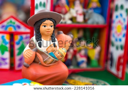 LIMA, PERU - CIRCA 2014: Ceramic figure of andean woman with her baby circa 2014 in Lima, Peru - stock photo