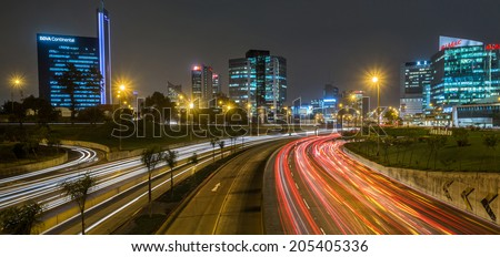 LIMA, PERU CIRCA 2014: Night view of skyline in San Isidro district and Lima highway  circa 2014 in Lima. - stock photo