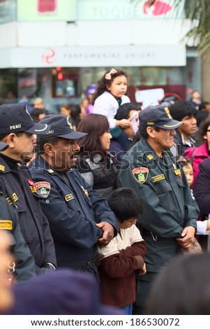 LIMA, PERU - JULY 21, 2013: Unidentified policemen on Wong Parade in Miraflores on July 21, 2013 in Lima, Peru. The Parade is held to celebrate the Peruvian national holiday which is on July 28-29. - stock photo