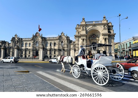 LIMA, PERU, MARCH 01: Carriage rolled tourists every Sunday and holidays by the Presidential Palace at Plaza de Armas in Lima, Peru, 01 march, 2011  - stock photo