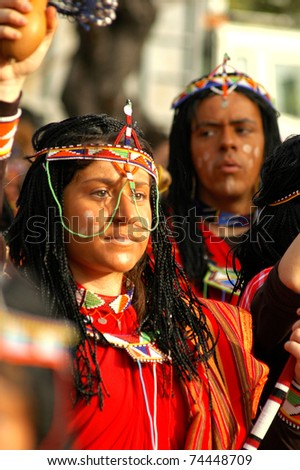 LIMASSOL, CYPRUS - FEBRUARY 14: Portrait of a woman disguised as an amazonian tribe member during the Carnival Parade on February 14, 2010 in Limassol, Cyprus. - stock photo