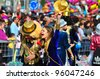 LIMASSOL, CYPRUS - MARCH 6: Unidentified Carnival participants  in a golden cylinder hats follow the Limassol Municipality Band during the annual Carnival Parade on March 6, 2011 in Limassol, Cyprus - stock photo