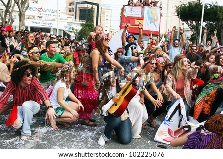 LIMASSOL, CYPRUS - MARCH 6: Unidentified participants  in hippie costumes in Cyprus carnival parade on March 6, 2011 in Limassol, Cyprus, established in 16th century, influenced by Venetians. - stock photo
