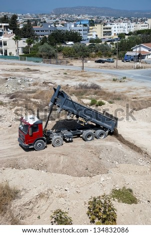 LIMASSOL,CYPRUS - OCTOBER, 2012:Construction site in a residential neighborhood, causing air pollution. in Limassol,Cyprus on October 2012 - stock photo