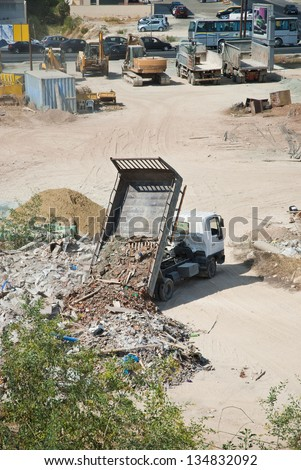 LIMASSOL,CYPRUS - OCTOBER, 2012:Illegal dumpsite for construction waste in a residential neighborhood, causing air pollution and the environment in Limassol,Cyprus on October 2012 - stock photo