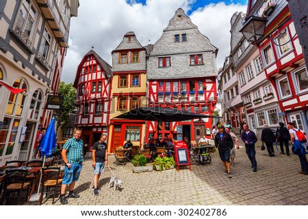 LIMBURG AN DER LAHN, GERMANY - JULY 25, 2015: old town of Limburg with unidentified people. Limburg is well known for its St Georgs Cathedral and its full set of nearly unscathed medieval buildings - stock photo