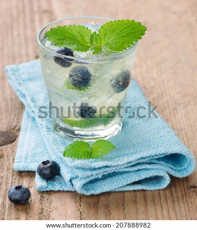 Lime and blueberry lemonade  - stock photo