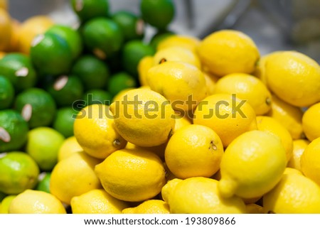 Lime and lemons for sale in a supermarket - stock photo