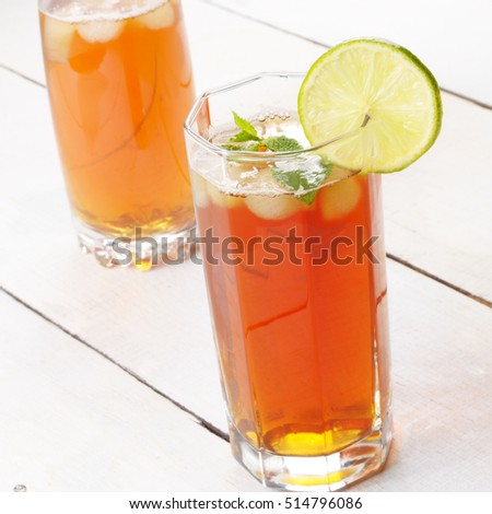 Lime and Mint Fruit Beer with ice on white table