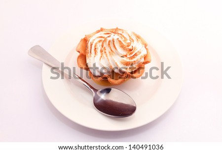 Lime curd Tart with Italian Meringue - stock photo