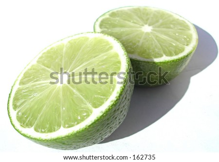 Lime cut in half - stock photo