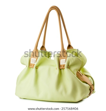 Lime female leather handbag isolated on white background - stock photo