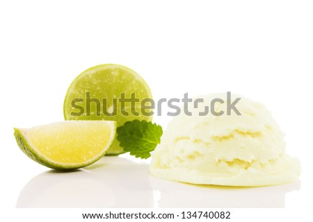 lime flavored ice cream with a lime slice and a lime blade and melissa on white background - stock photo