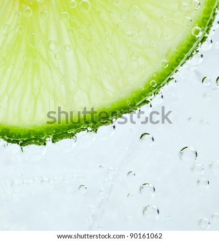 Lime floating in sparkling water - stock photo