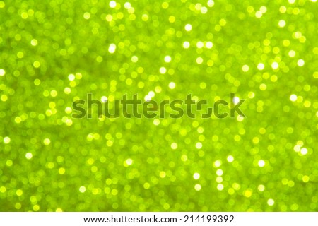 Lime green abstract blur bokeh lights. defocused background.