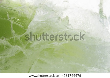 Lime green ice texture background made of frozen ice - stock photo