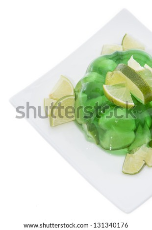 Lime Jello with freh fruits Lime Jello isolated on white background